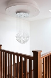 Crystal droplets over a lofty stairwell
