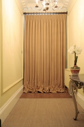 Indulgent drape to shield the draft from an imposing front door