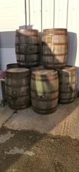 Full and half whisky barrels. also barrel staves