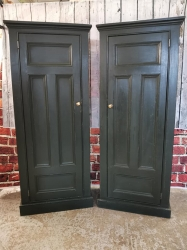 A near pair of matching linen, toy  or hall cupboards