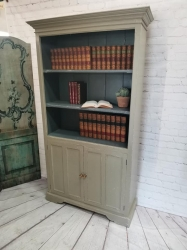 Tall painted and distressed bookcase with doors