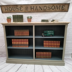 Lovely painted and distressed bookcase with old pine top