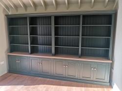 Huge bespoke handmade bookcase in studio green