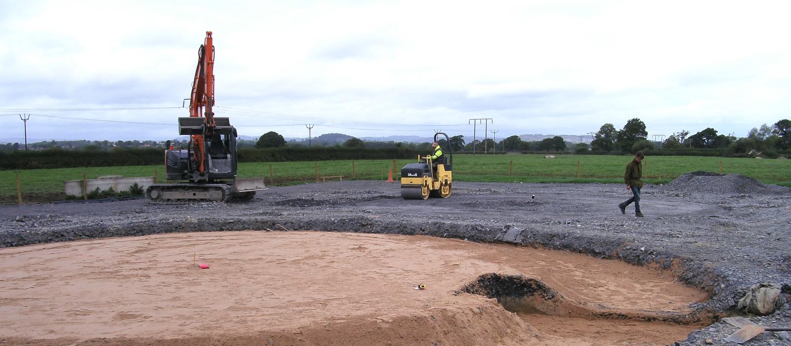 A Modern Excavator Flattening Land
