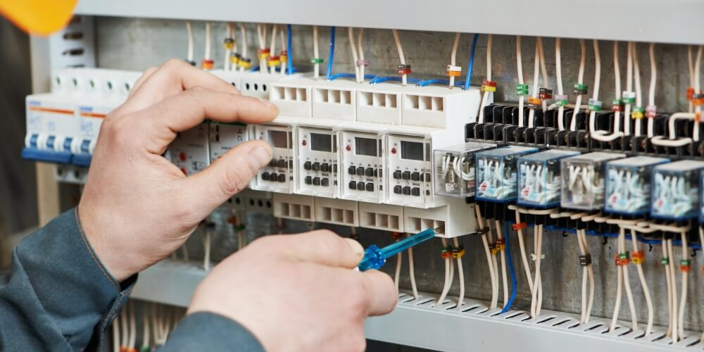 Electrician checking the Voltage of a Circuit