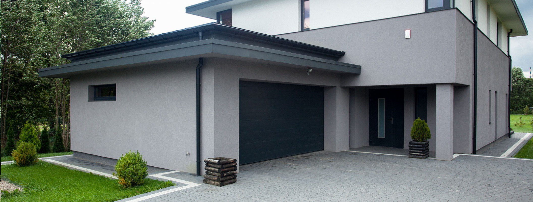Modern house with grey block paving driveway