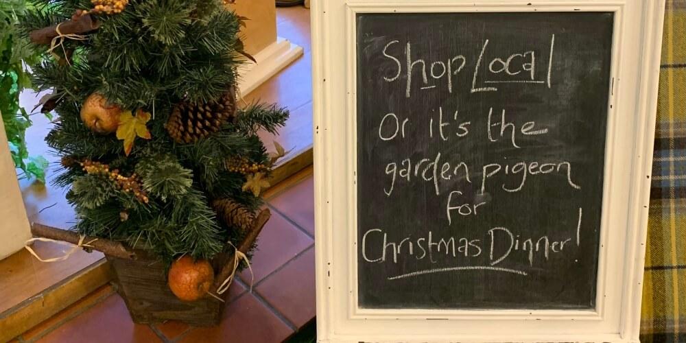 Chalkboard saying shop locally