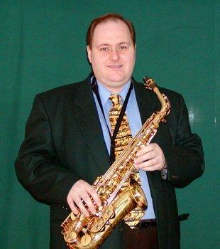 Mark Toomey holding a saxophone