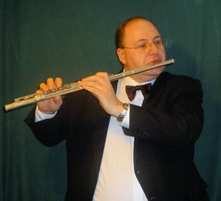 Mark Toomey playing a flute
