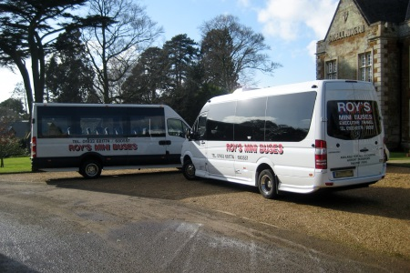 Two of Roy's Mini buses