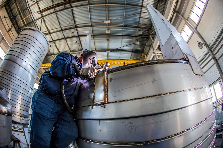 Welder working on a steel structure
