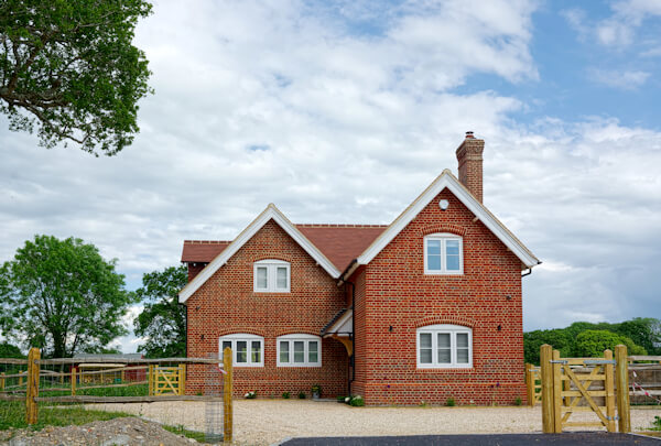 Large detached new build house set in the UK countryside with large driveway
