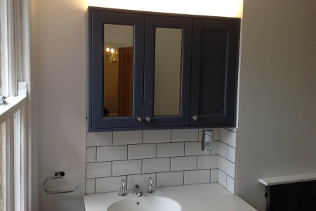 Newly fitted bathroom sink and cupboard