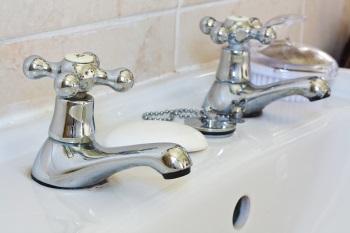 Bathroom sink in need of plumbing repair
