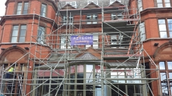 Scaffolding on front of building with Aztech Scaffolding's logo on.