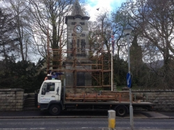 Truck with Scaffolding equipment on the back parked infront of clock tower