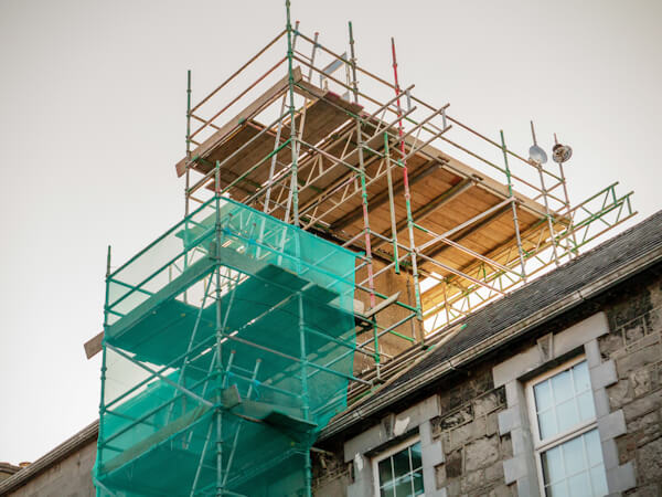 Scaffolding set on an old house to repair chimney.