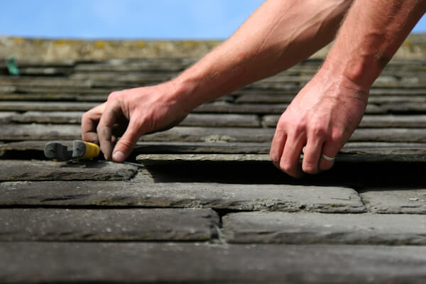 Slate Roofing tiles being laid