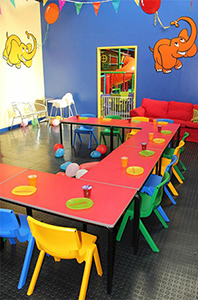 Colourful Tables and Chairs setup for lunch at Giggles Play Mill