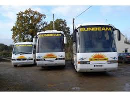 Three large sunbeam coaches parked up