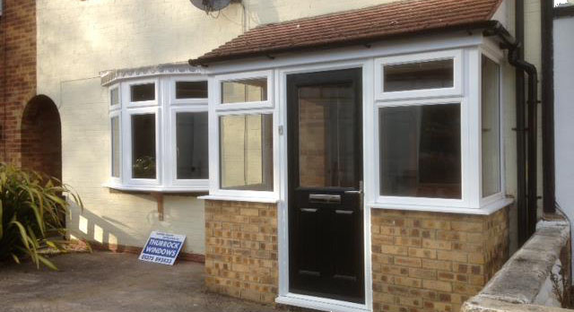 Extension at front of house with new windows and door